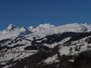 Pez Tumpiv, Biferten, Alp Dado with ski runs above Brigels as seen from Ruschein