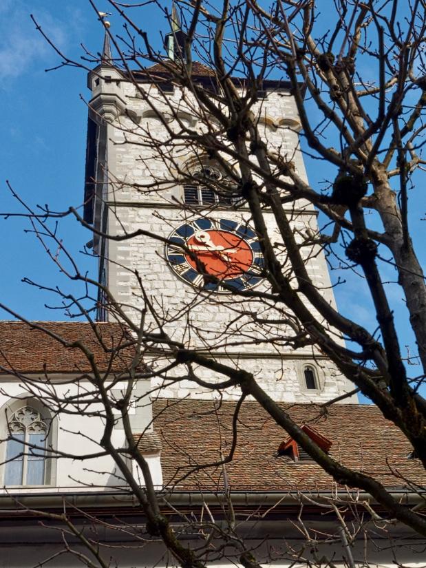 Impressive belfry soars above trees